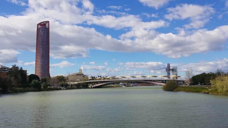 Buildings and bridge in the Guadalquivir river